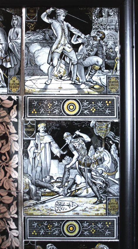 "The tiles on each side of the fireplace are separated by decorative 'strip' tiles 1 1/2"" x 6"" in size. The lower picture tile shown here illustrates a scene from the book ""Ivanhoe"" [see top left], and the scene from Chapter XLIV [44] showing the ""Death of Bois-Gvilbert"" [see bottom right]. The tiles are lovely to look at, but are not a restful collection of images!"