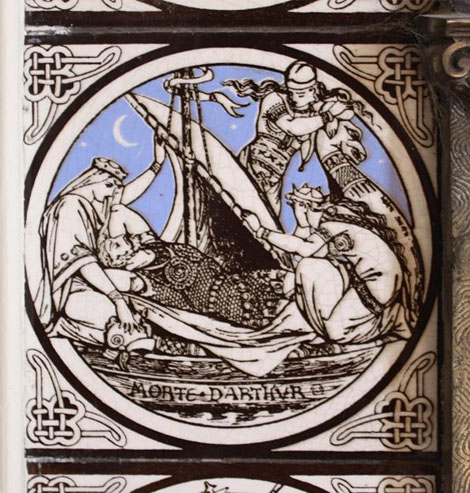 The tile depicting the death of Arthur, at night under the moon and a starry sky, in a dragon-headed boat attended by three damsels.