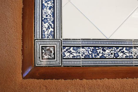 "The hearth design of the ""His"" fireplace in the master suite at ""Jolimont"" is formed of cobalt blue apple blossom design border tiles with matching corner tiles. This hearth had to be recreated during the restoration of the house."