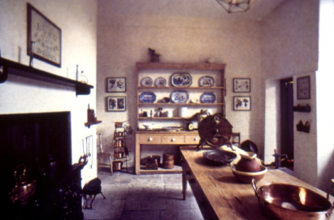Pallant House Gallery and Historic site, Chichester, England c1820. Restored kitchen. This kitchen is typical for the Georgian to late Victoria period. A 'range' in the chimney, a dresser and a kitchen table were usual requirements.