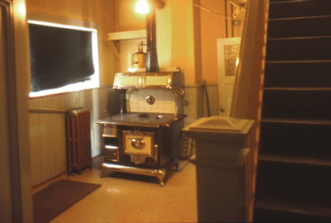 Two pictures from another 'unchanged' home. The stove, dating from around 1915 was still in use, as was the sink with its angled wooden draining boards. The original tongue and groove wainscoting was still in place from c1895. Photographs taken 1980's.